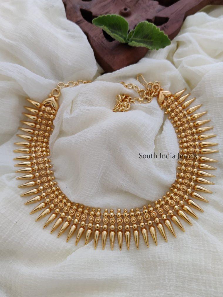 Mullamottu necklace looks very simple and elegant. Necklace - Length 40.64 cms, gold polish.